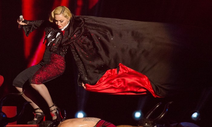 LONDON, ENGLAND - FEBRUARY 25: Madonna falls as she performs on stage for the BRIT Awards 2015 at The O2 Arena on February 25, 2015 in London, United Kingdom (Photo by Samir Hussein/Redferns via Getty Images)
